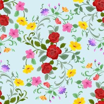 赤いバラと花のシームレスなパターンのファブリックテキスタイル。