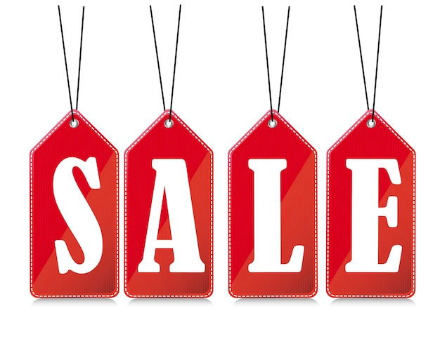 Red sale tags with shadow over white background