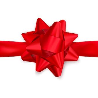 Красная атласная лента и лук сверху. элемент украшения для дня святого валентина или другого праздника.