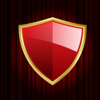 Red shield on red curtain background