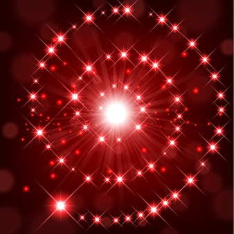 Red shine with sparkle forming spiral background