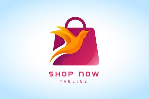 オレンジ色の飛ぶ鳥のグラデーションのロゴが付いた赤いショッピングバッグ