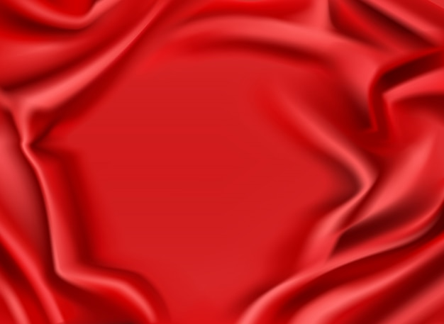 Red silk draped fabric background. luxurious folded glossy scarlet textile frame with smooth center