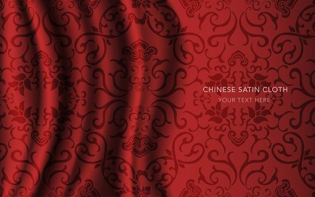 パターン、クロスつる花と赤い絹のサテン生地の布