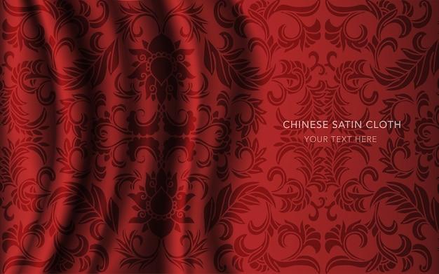 パターン、庭の花のつると赤い絹のサテン生地の布