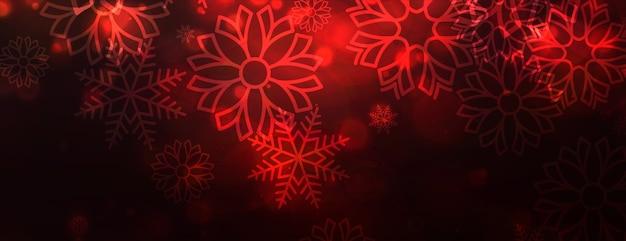 メリークリスマスの赤い雪片の光沢のあるバナー