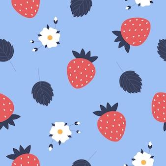 青い背景の上の赤いイチゴシームレスなパターン