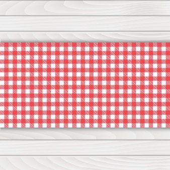 Red tablecloth on white wood table