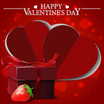 Red valentine's day greeting card with gift and strawberry