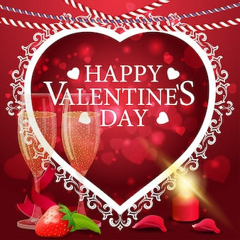 Red valentine's day greeting card with glasses of champagne