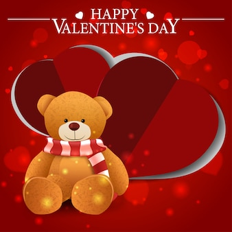 Red valentine's day greeting card with teddy bear