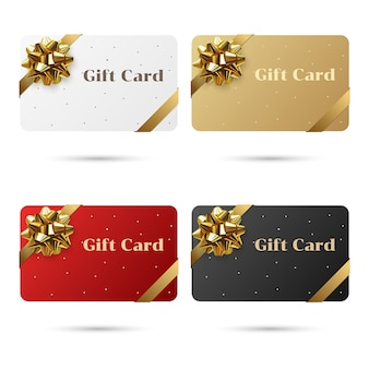 Red, white, black, gold set of blank gift cards with golden bow and ribbon.