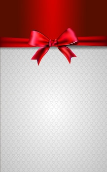 Red and white card with a bow