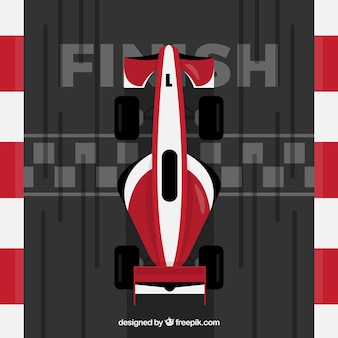 Red and white f1 racing car crosses finish line