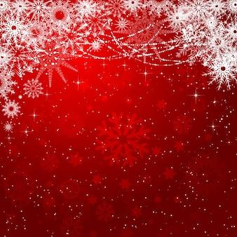 Rosso e bianchi fiocchi di neve sfondo