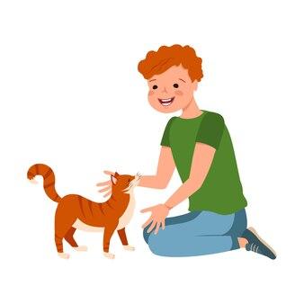 주근깨가 있는 빨간 머리 소년과 고양이