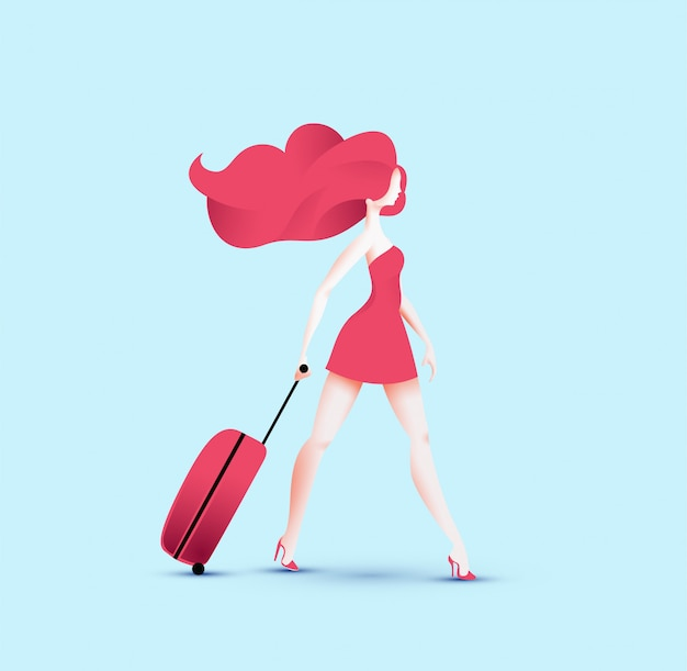 Redhead pretty traveler girl in red dress walking with red travel roller bag.