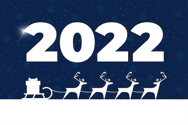 Оленьи упряжи с подарочной коробкой на санях поздравительная открытка с рождеством и новым 2022 годом