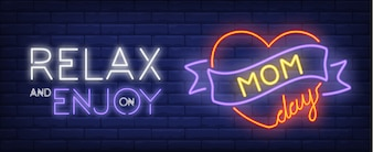 Relax and enjoy on mom day neon sign. Red heart with purple ribbon.