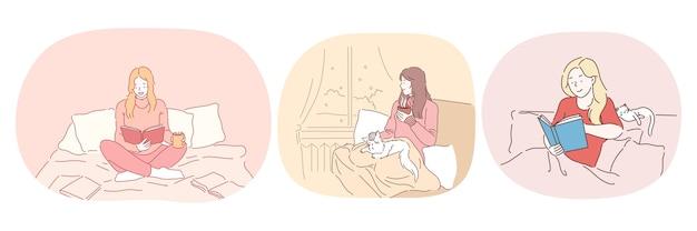편안한 집에서 게으른 침구 시간 긍정적 인 여성 집에서 책으로 휴식