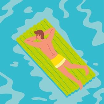 Расслабленный мужчина на поплавковой кровати