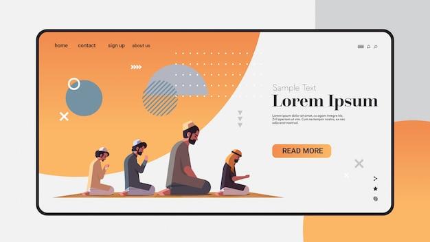 Religious muslim men kneeling and praying on carpet ramadan kareem holy month religion concept full length horizontal copy space