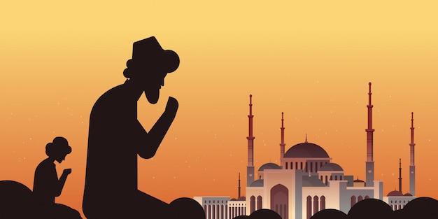 Ключевые слова на русском: религиозные мусульманские мужчины силуэты на коленях и молиться рамадан карим священный месяц религия набави мечеть здание закат фон плоский портрет горизонтальный