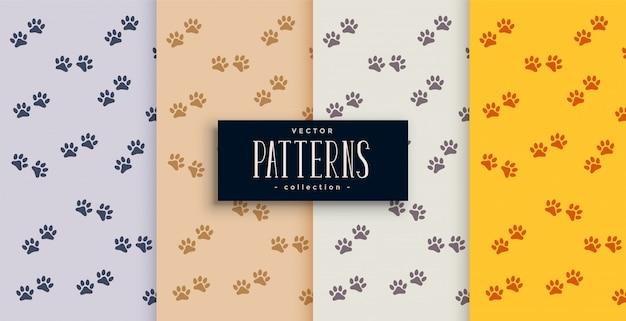 繰り返し犬または猫の足の印刷パターンセット