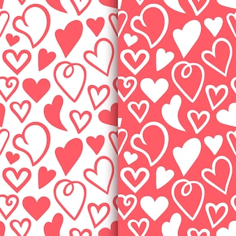 Repeated outlines of hearts drawn by hand romantic seamless pattern set