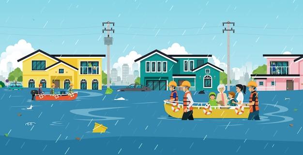 救助者は人々を洪水地域から追い出すのを助けています