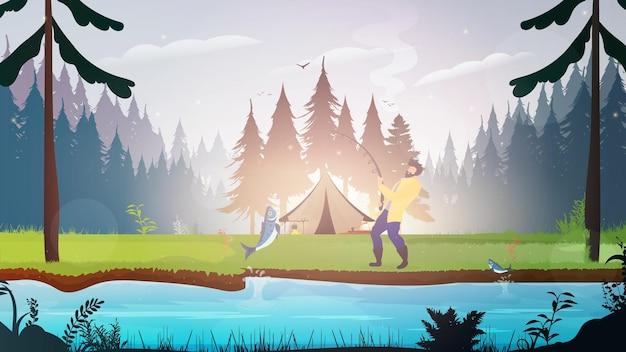 森の中でテントを張って休んでください。男は川から大きな魚を引っ張る