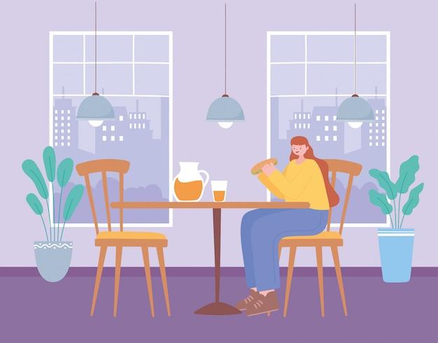 レストランの社会的距離、ファーストフードを食べる女性、コロナウイルス感染の予防