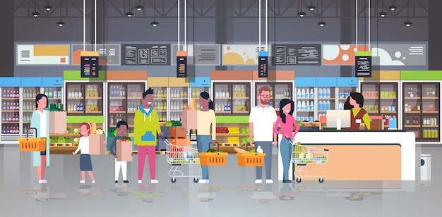 Retail woman cashier at checkout supermarket