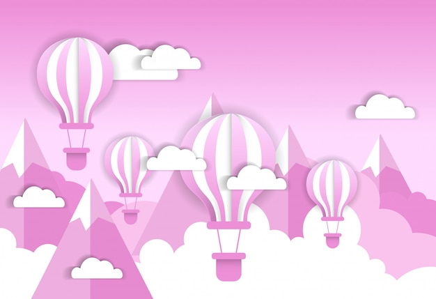 Retro air balloon over pink clouds and mountains