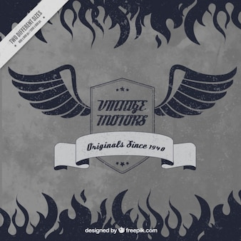 Retro background of motorcycle badge with wings and flames