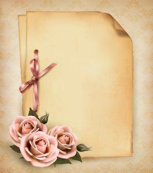 아름 다운 핑크 장미와 오래 된 종이와 레트로 배경