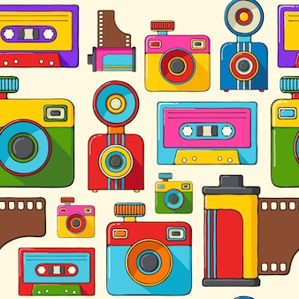 Retro cameras and audio cassettes hand drawn pop art style seamless pattern.