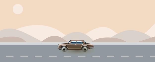 道路を走る80年代からのレトロな車。夏のオートトリップ