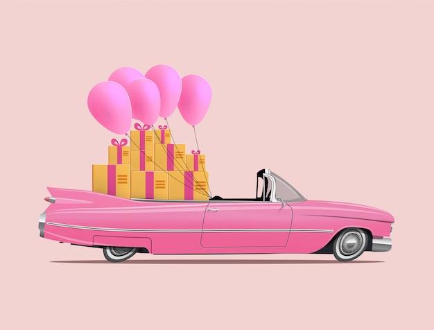 ギフトボックスとピンクの風船の完全な大広間とレトロな漫画ピンク車ロードスター。