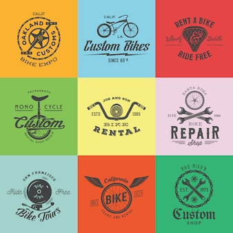 Retro custom bicycle   labels or logo templates set. bike symbols, such as chains, wheels, saddle, bell, wrench, etc. with vintage typography.