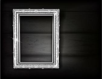 Retro of silver frame photo on black wood