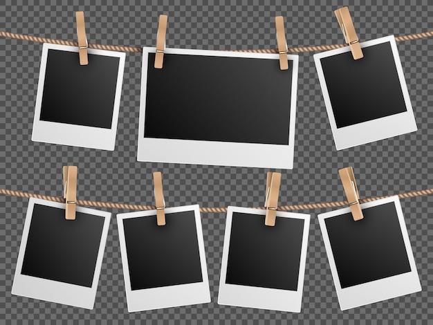 Retro photo frames hanging on rope