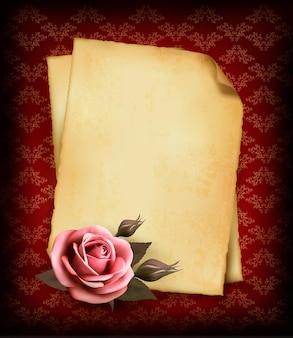 레트로 핑크 장미와 오래 된 종이입니다.