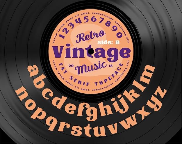 레트로 빈티지 세리프 굵은 서체. 비닐 레코드의 배경에 알파벳 문자입니다.