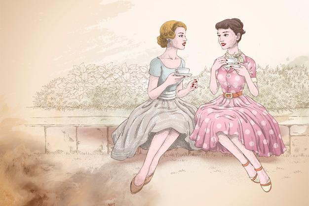 庭で一緒にアフタヌーンティーを持っているレトロな女性