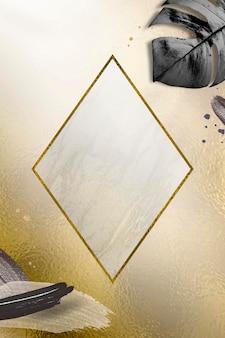 メタリックモンステラの葉の背景を持つ菱形ゴールドフレーム