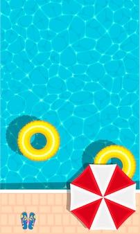 상쾌한 푸른 수영장에 떠있는 반지