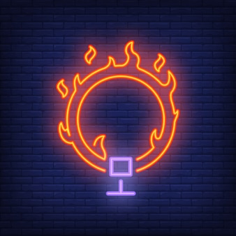 Ring on fire neon icon. Circus flaming hoop on dark brick wall background.
