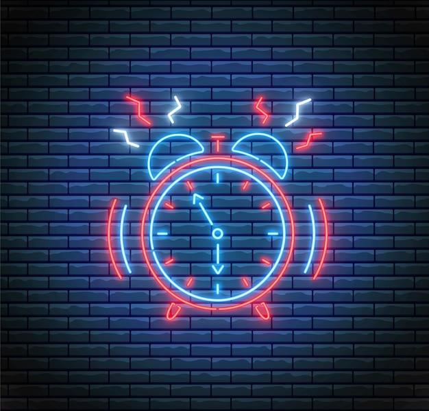 ネオンスタイルの目覚まし時計を鳴らします。時間の概念。 ledライトイラスト。レンガの壁のタイマー。