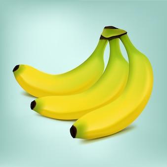 Спелые бананы на зеленом фоне